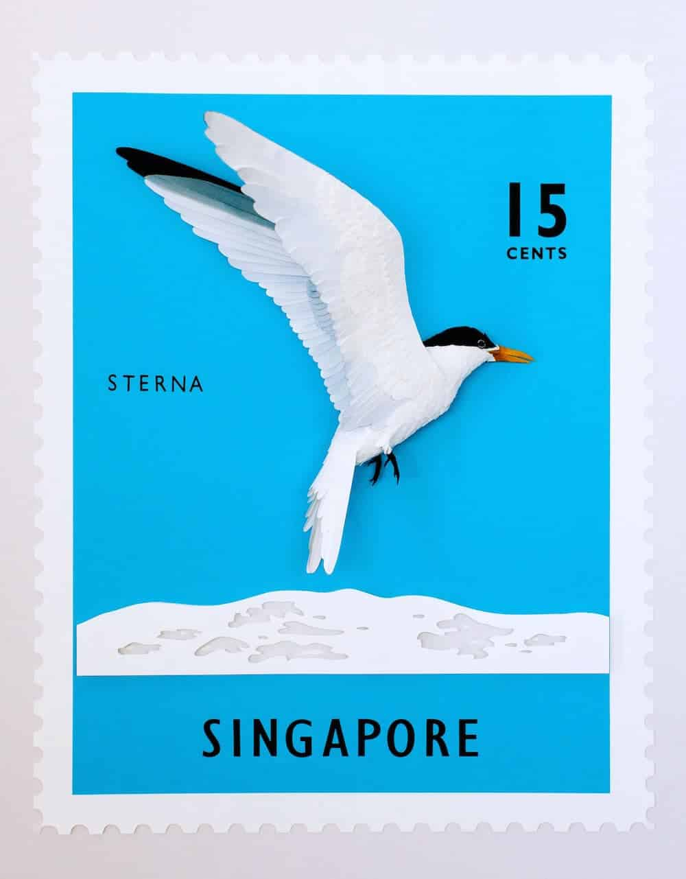 postzegel met papieren vogel